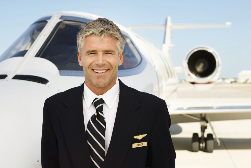 Pilot in Front of Private Jet